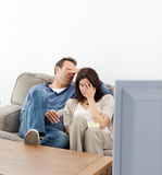 Couple hiding their faces while watching a movie Royalty Free Stock Image