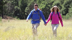 Couple On Hike In Beautiful Countryside stock video footage