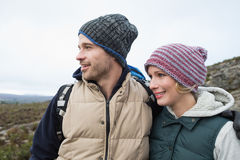 Couple on a hike in the countryside against clear sky Stock Images