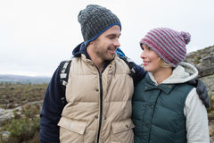 Couple on a hike in the countryside against clear sky Royalty Free Stock Images