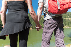Couple on hike hand in hand Royalty Free Stock Photos
