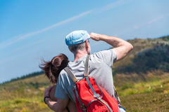 Couple on hike looking at the landscape Royalty Free Stock Images