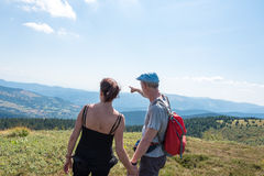 Couple on hike looking at the landscape Royalty Free Stock Image