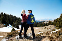 Couple of hikers with backpack standing top of mountain Stock Photography