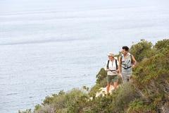 Couple of hikers enjoying trip royalty free stock photo