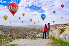 Couple of hikers enjoying valley view in Cappadocia, Turkey Stock Images