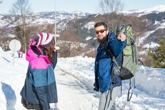 Couple of hikers exploring snowy mountain. On a sunny day Royalty Free Stock Photos