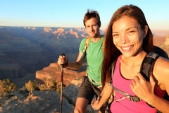 Couple hikers in Grand Canyon. Aspirational lifestyle image of happy young people hiking the South Rim trail of Grand Canyon. Multiethnic couple, Asian woman Stock Photo