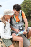 Couple of hikers looking at map Stock Photo