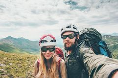 Couple hikers Man and Woman together taking selfie climbing in mountains Travel Lifestyle concept tourists wearing helmet. Gear Royalty Free Stock Photo