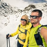 Couple hikers, partnership and teamwork in winter mountains Royalty Free Stock Photography