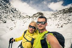 Couple hikers selfie portrait in winter mountains Royalty Free Stock Photo