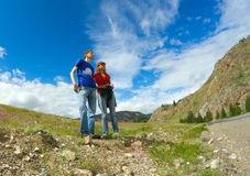 Couple hikers mountains Stock Photo