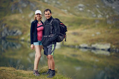 Couple of hikers near the lake Stock Image