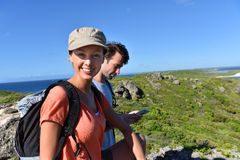 Couple of hikers sightseeing carribean coast royalty free stock photography