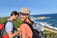 Couple of hikers sightseeing the island royalty free stock image