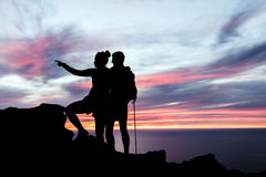 Couple hikers silhouette in mountains Royalty Free Stock Photography