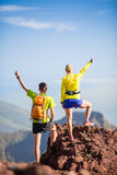 Couple hikers or trail runners in mountains Stock Photo