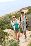 Couple of hikers visiting island's nature royalty free stock photography