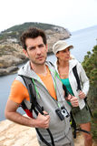 Couple of hikers visiting islands royalty free stock photography