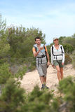 Couple of hikers visiting islands royalty free stock photo