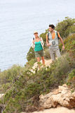 Couple of hikers visiting natural landscape by the sea royalty free stock photography