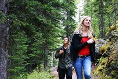 Couple hiking. On a path near Lake Moraine Royalty Free Stock Image