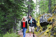 Couple hiking. On a trail at Lake Moraine Stock Image
