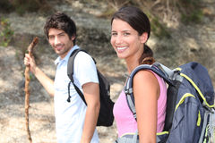 Couple hiking Stock Images