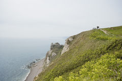 Couple Hiking Atop Cliff Royalty Free Stock Images