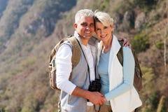 Couple hiking autumn mountain. Portrait of happy couple hiking in autumn mountain royalty free stock images