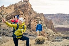 Couple hiking with baby boy travelling in backpack Stock Image