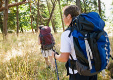 Couple hiking with backpacks Royalty Free Stock Photo
