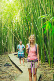 Couple hiking through bamboo forest Royalty Free Stock Photos