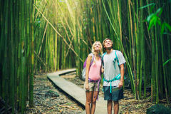 Couple hiking through bamboo forest Royalty Free Stock Images