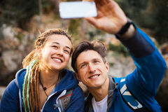 Couple hiking in the forest Royalty Free Stock Images