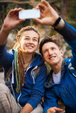 Couple hiking in the forest Royalty Free Stock Photos