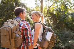 Couple hiking forest Stock Images