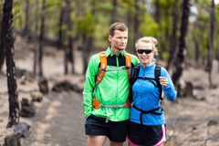 Couple hiking in forest stock images