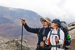 Couple Hiking in Himalaya Mountains royalty free stock photography