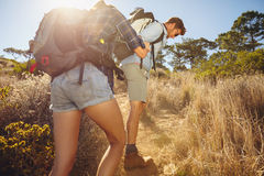 Couple hiking in mountain on a hot sunny day Stock Image