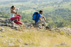 Couple hiking on the mountain Stock Photography