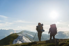 Couple hiking in mountains Royalty Free Stock Images