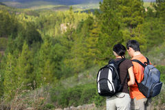 Couple hiking in the mountains Stock Photo