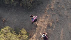 Couple hiking in mountains stock footage