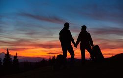 Couple hiking in the mountains together stock photography