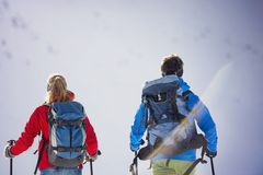 Couple hiking outside in winter nature royalty free stock photography