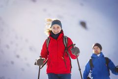 Couple hiking outside in winter nature Royalty Free Stock Photos