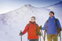 Couple hiking outside in winter nature stock photos