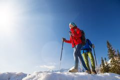 Couple hiking outside in winter nature stock photo